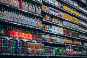 save money at the grocery store by looking at the bottom shelf
