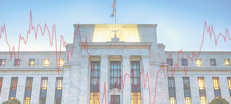 rising interest rate line graph in front of building