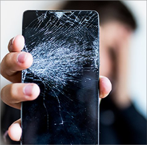 Person holding a phone with a cracked screen