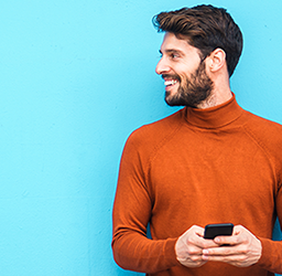 Man holding a phone and smiling